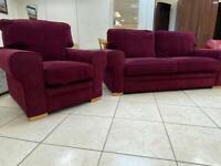 Beautiful deep purple sofa and matching armchair