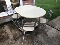 Foldaway dining table and chairs. Can deliver.