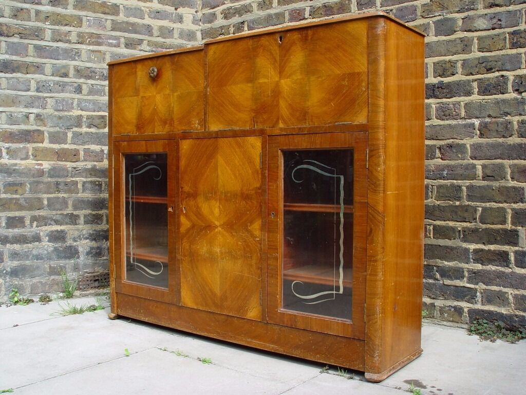 FREE DELIVERY Unique Vintage Cocktail Cabinet Writing Bureau Retro Furniture 66in Camden, LondonGumtree - This is a beautiful cocktail cabinet with writing bureau. The unit has a storage area for bottles in the centre and two storage areas on either side with unique glass panel doors. The cocktail bar area opens to reveal the glass mixing area whilst on...