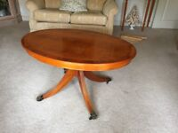 Yew oval coffee table