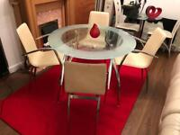 Table and 4 Chairs in excellent condition