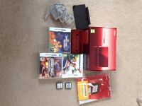 Red Nintendo 3DS with box, stylus, charger, charging dock and 5 games