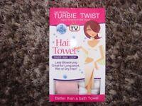 2 Turbie Twist hair towels. Brand new in box. pink & white. £2. Torquay.