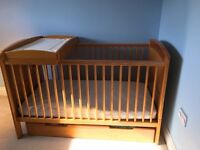 Cot bed, under draw, changing area and bedding.