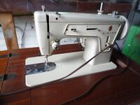 SINGER SEWING MACHINE ON TABLE FOLD AWAY IN GOOD WORKING ORDER