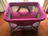 Nuna Sena mini travel cot in pink/purple