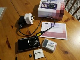 Samsung ST600 14.2 MP digital camera original packaging with SD card and 2 batteries