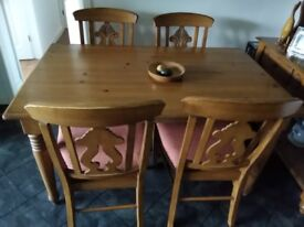 Table and 4 chairs in distressed oak.