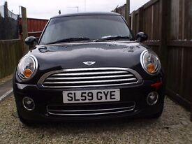 price drop Beautiful Mini First late sept model 2009 with very low miles in pearl metallic black