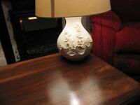Ceramic table lamp with floral relief on the base
