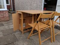 Fold away table & 4 chairs