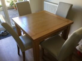 Oak extendable table & four chairs in very good condition
