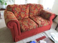 Two seater settee. Autumn colours. Very comfortable.