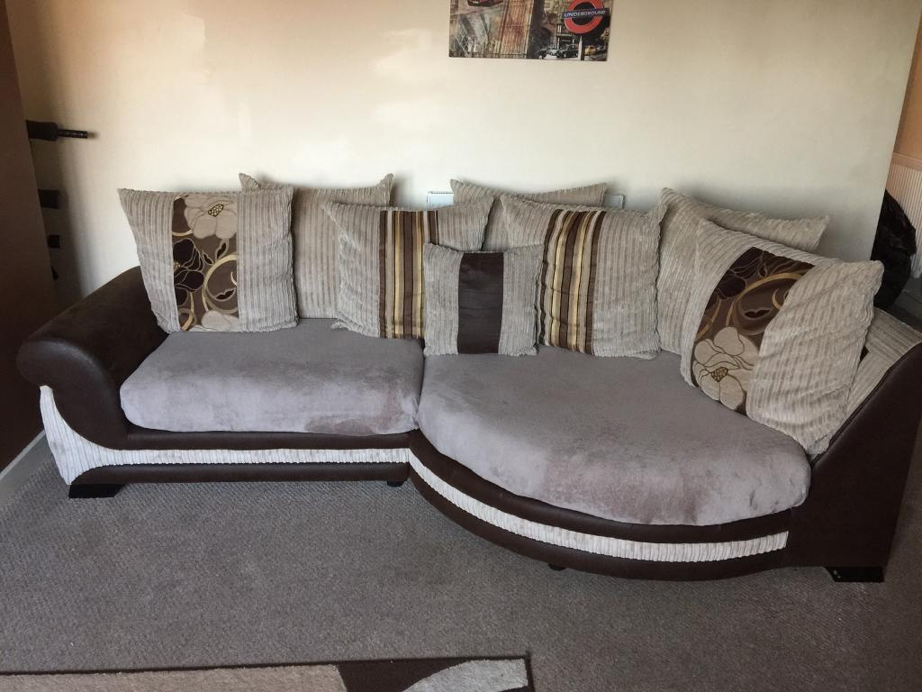 Stone choc cuddle sofa with a large twister chair and half moon
