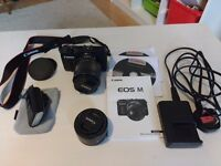 "Canon Eos M compact system camera plus 18-55mm kit lens plus extra 22mm ""prime"" lens"