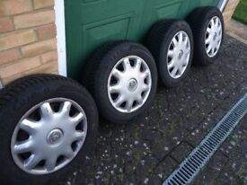 Goodyear Ultragrip 8 Winter tyres, on steel rims with hub cap covers. Tyre size 195/ 65R15 91H
