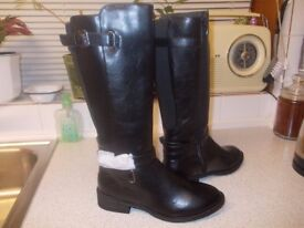 black knee high boots brand new size 4