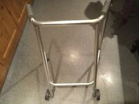 WHEELED ADJUSTABLE ZIMMER FRAME. Bought for visiting relative and only used indoors. BARGAIN.