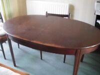 American Walnut oval extending dining table