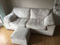 Cream ribbed sofa and matching footstool