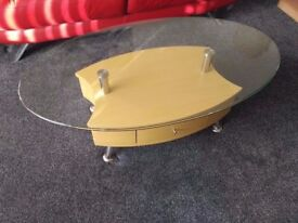 Oval glass top coffee table in Hamilton