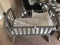 Sophie's swinging cot with Mattress and bedding.
