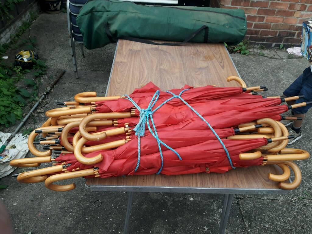 Big job lot of red umberellas