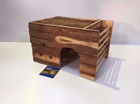 Large wooden rabbit/ guinea pig house with hay rack.
