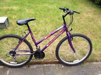 "Universal women's bike 26"" wheels,18 gears,19"" frame, used condition working order."