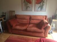 Three seater sofa and free matching armchair