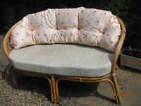 Cane conservatory settee ,also could be rocker chair if wanted,