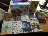 2 Nintendo Wii 's with lots of extras