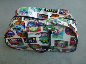 pull along colourful travel bag with wheels.