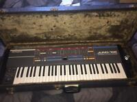 Juno 106 with hard case + extras