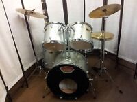 Retired drum teacher has a student drum kit with upgraded Sabian or Paiste cymbals for sale.