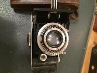 Collection of vintage cameras and lenses