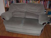 Two seater green sofa quality item good condition really comfortable.