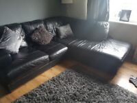Black leather corner sofa and snuggle chair DFS