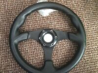 Aftermarket black leather steering wheel