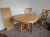 Dining table round with two chairs & plus one carver chair.