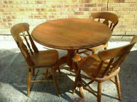 Small pine pedestal table and 3 chairs