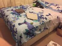 Large double bed with storage