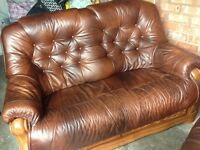Two tan leather sofas with oak frame and drawers underneath