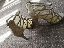 Gold heels,straps. Size 5, excellent condition