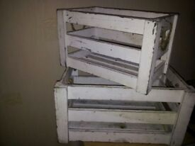 Two white slatted crates, small and medium size