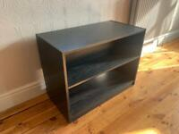 TV games storage cabinet with shelf in black wood.