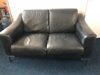 Lovely black leather two seater sofa