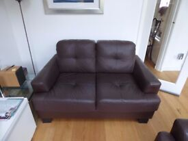 2 dark brown leather sofas. Ideal for compact spaces. £25 each for quick sale