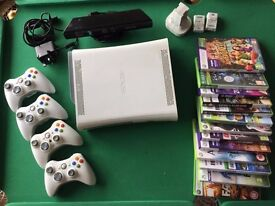 Boxed Xbox 360 with Kinect + 4Remotes + charger + 13 Games