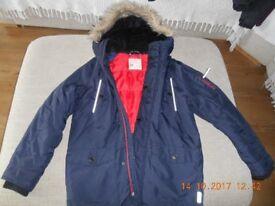 Next coat aged 9 years